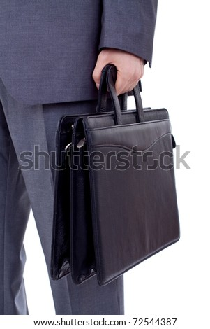 Low section image of a business person holding a suitcase - stock photo