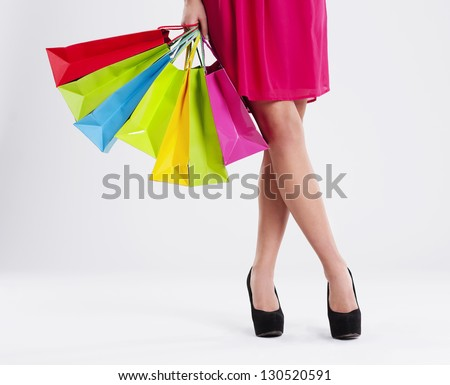 Low section of a woman with full of shopping bags - stock photo