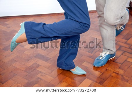 Low section of elderly couple dancing - stock photo
