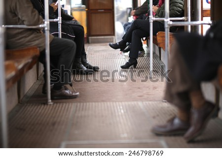 Low section of public transport passengers - stock photo