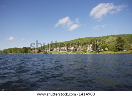 Low shot from Lake at Luxury Lake Homes - stock photo