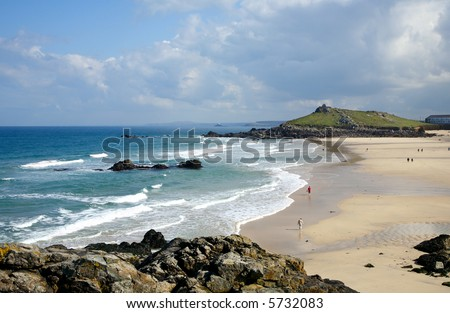 Low spring tide at Porthmeor beach in St. Ives, Cornwall, UK - stock photo