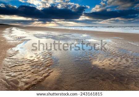 low tide at sunset on North sea, North Holland, Netherlands - stock photo
