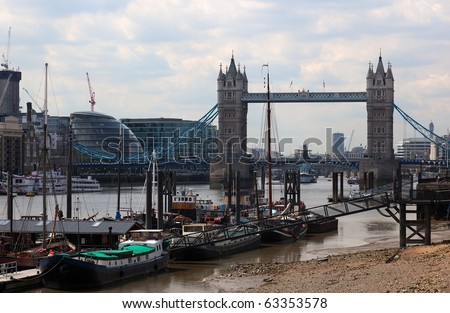 Low tide. Boats and Tower Bridge. London. UK. - stock photo