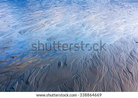 low-tide ocean water texture, location - New Zealand - stock photo