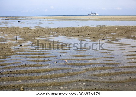 Low tide on the sea side in the morning  - stock photo