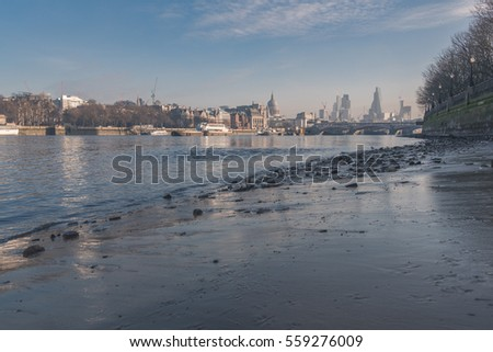 Low tide  River Thames in London, the view to the north shore with the St Paul's Cathedral