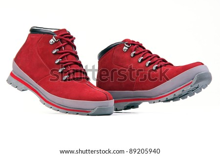 Low top hiking boots over white - stock photo