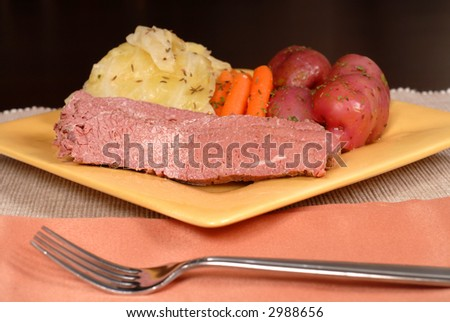 Low view of a  corned beef and cabbage dinner with potatoes and carrots - stock photo