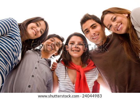 Low view of a group of happy people isolated on a white background