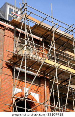 Low view of a scaffold and house