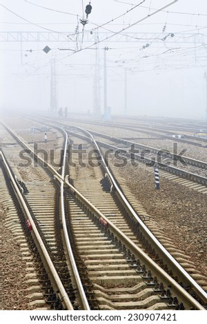 Low visibility. Railway station in fog - stock photo