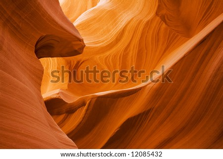 Lower Antelope Canyon located near Page Arizona on the Navajo reservation. A slot canyon is a narrow canyon, formed by the wear of water rushing through rock. - stock photo