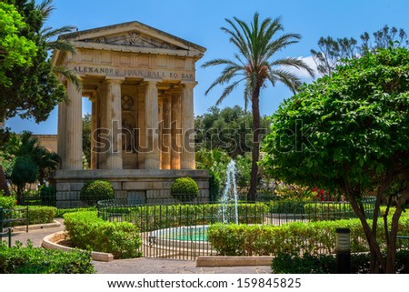 Lower Barrakka gardens and the monument to Alexander Ball in Valletta. - stock photo
