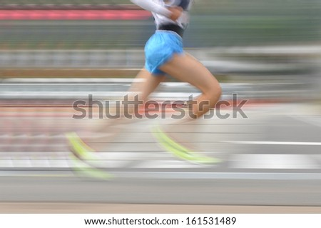 Lower body of a runner wearing shorts. - stock photo