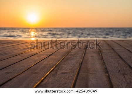 Lower deck of diving boat at the sea early in the morning lit with rising sun - stock photo