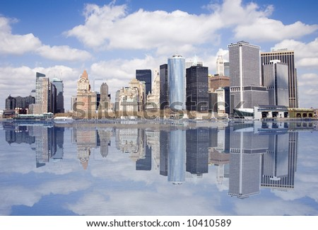 Lower end of Manhattan with reflection as seen form New York Harbor. - stock photo