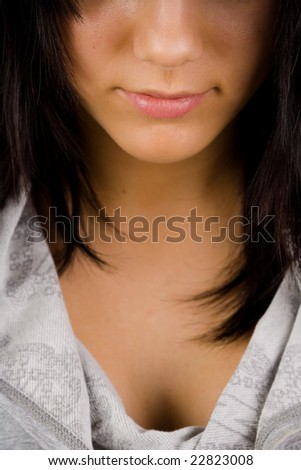 Lower half face and chest of a beautiful brunette - stock photo