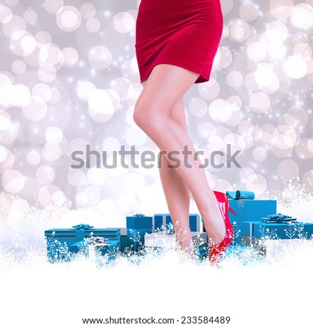 Lower half of girl in red skirt and heels against light glowing dots design pattern - stock photo
