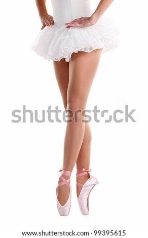 Lower half waist down image of ballerina dancing on pointe - stock photo
