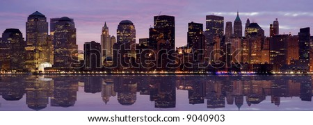 Lower Manhattan at Dawn with reflection in Hudson River. - stock photo
