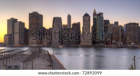 Lower Manhattan at night from the Brooklyn Heights Promenade. - stock photo