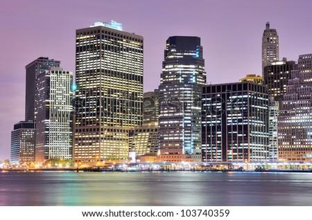 Lower Manhattan at night in New York City - stock photo