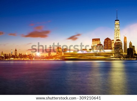 Lower Manhattan in New York City at sunrise with cruise ship passing by - stock photo