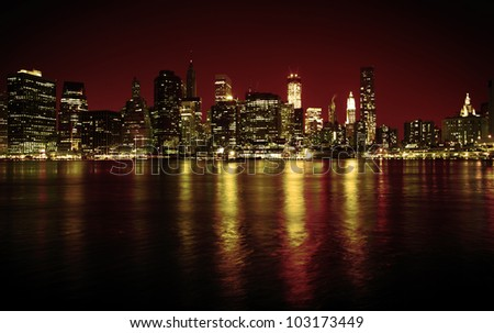 Lower Manhattan in New York in a red hue at nighttime - stock photo