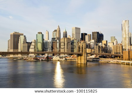 Lower Manhattan in the background of Brooklyn Bridge in a sunny morning, New York, United States - stock photo