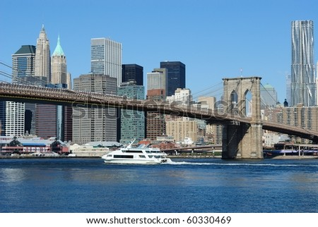 Lower Manhattan including the brooklyn bridge from across the East River in New York City. - stock photo