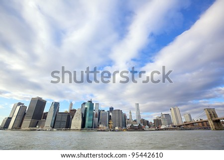 Lower Manhattan skyline and Brooklyn Bridge over East River in New York City