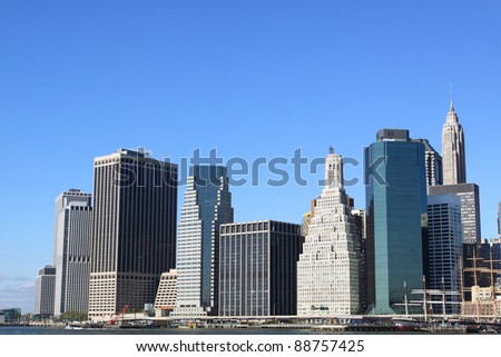 Lower Manhattan Skyline and Skyscrapers on a Clear Blue Sky from Brooklyn, New York City - stock photo