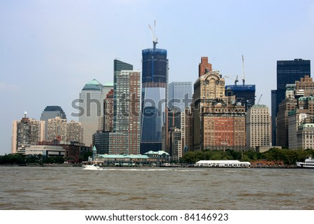 Lower Manhattan skyline at Battery Park (World Trade Center construction in the background). - stock photo