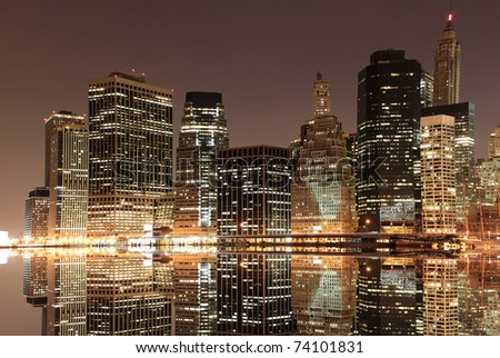 Lower Manhattan Skyline At Night From Brooklyn, New York City - stock photo