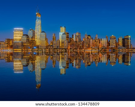 Lower Manhattan skyline at night reflected in water