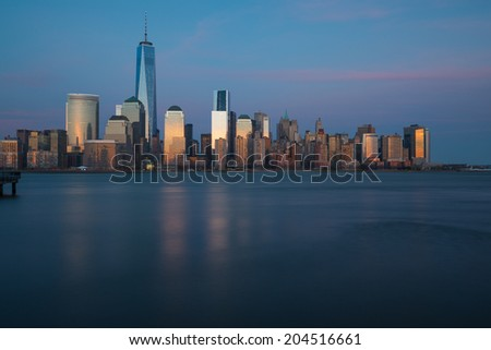 "Lower Manhattan skyline during ""blue hour"" as seen from Exchange Place, New Jersey"
