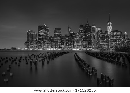 Lower Manhattan skyline from Brooklyn Bridge Park at night - stock photo