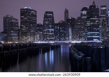 Lower Manhattan skyline night view from Brooklyn Bridge Park in New York City. - stock photo