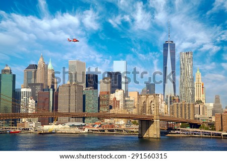 Lower Manhattan skyline with Brooklyn Bridge, New York City - stock photo