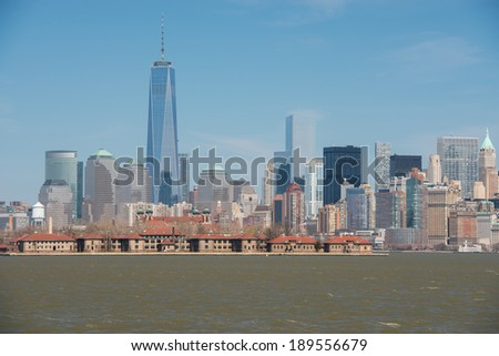 Lower Manhattan skyline with Ellis Island in the foreground as seen from Liberty State Park, New Jersey - stock photo