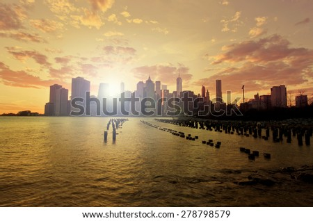 Lower Manhattan with Instagram style sun flare and filter - stock photo