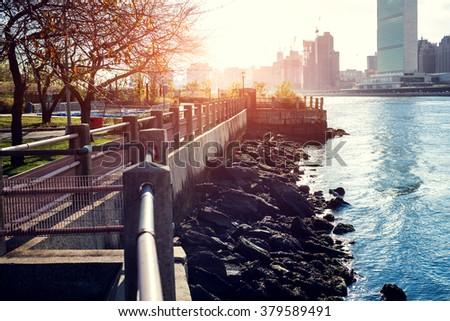 Lower Manhattanat sunset as viewed from Hudson River Park - stock photo