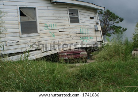 Lower Ninth Ward, New Orleans one year after hurricane Katrina struck the gulf coast. House on Automobile - stock photo