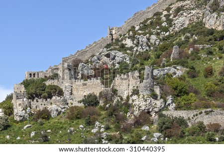Lower part of St. Hilarion castle on a steep hilltop over Kirenia (Girne), North Cyprus - stock photo