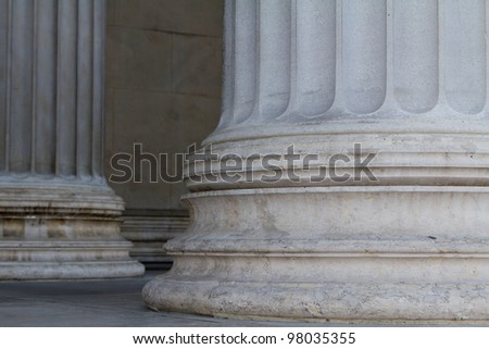 Lower parts of two pillars in front of the Austrian Parliament symbolizing strength and the foundation of democracy - stock photo