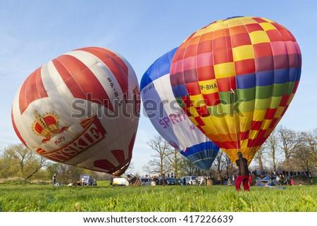 LOWER SILESIA, POLAND- APRIL 30, 2016:International Hot Air Balloon festival. Start of hot air balloons in Krzyzowa,a village in Lower Silesia region in Poland. - stock photo