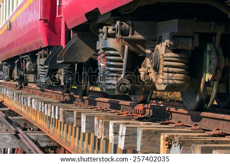 lower view of trains suspension on old wood railways bridge - stock photo