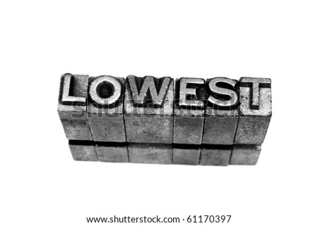 LOWEST written in metallic letters on a white background - stock photo