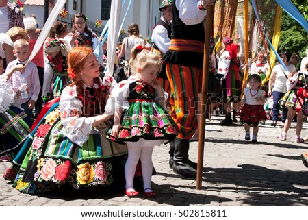 Lowicz, Poland - June 04,2015: procession in folk costumes during the celebration of Corpus Christi